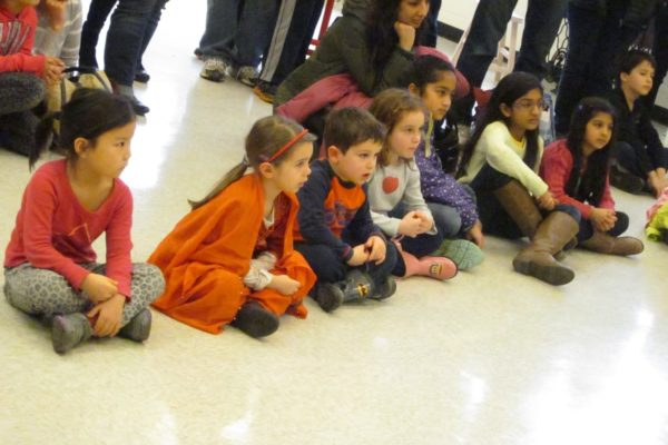KID Museum visitors sit and watch the dancers!