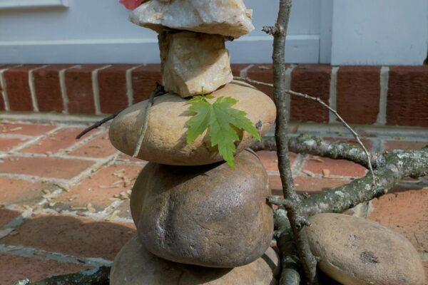 Stack strong materials to make a standing sculpture